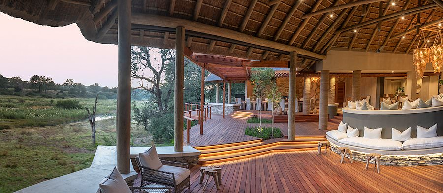 Dulini River Lodge's glass-walled lounge area.