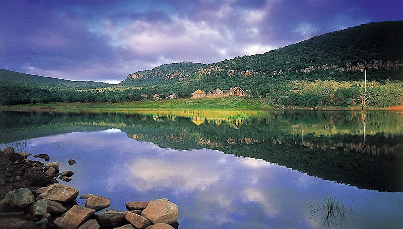 Entabeni Lake reflects the wilderness and sky above it.