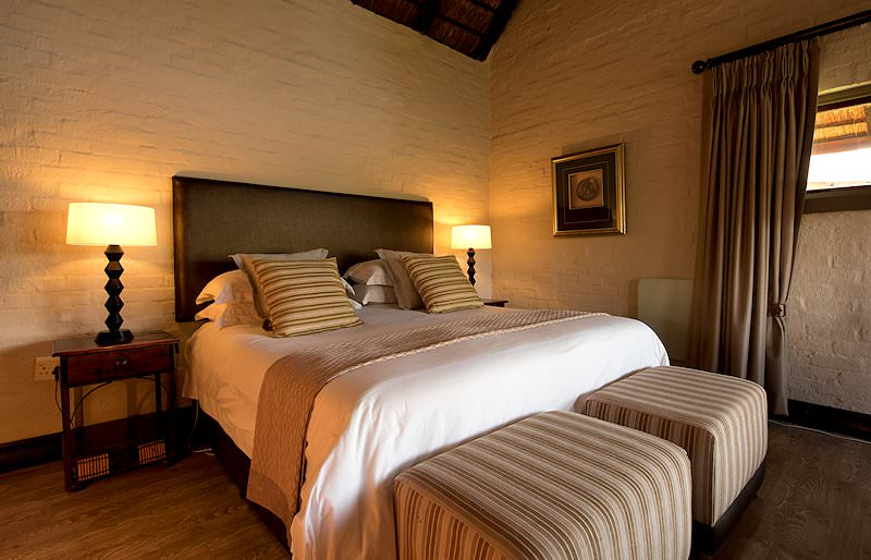 A comfortable queen-size bed in a room at Entabeni Lakeside Lodge.