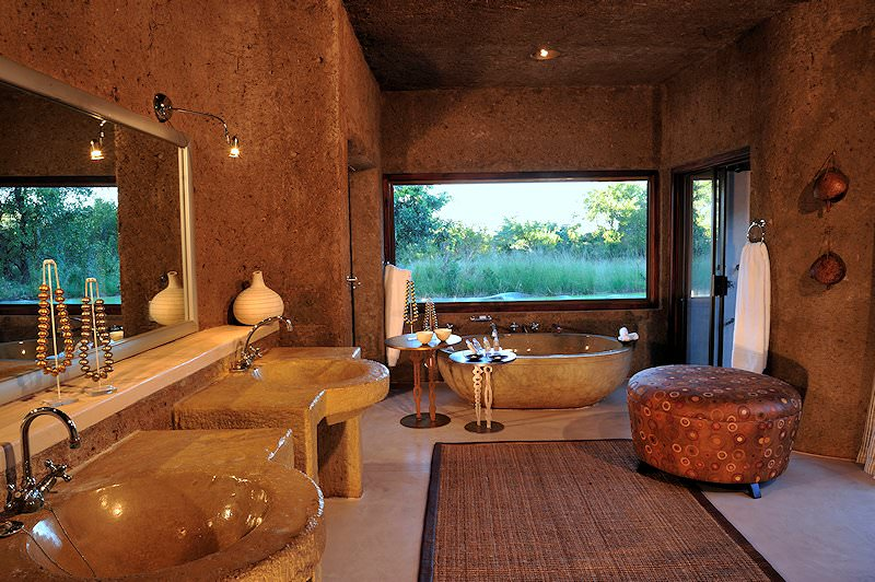 The bathroom of one of the suites at Sabi Sabi Earth Lodge.