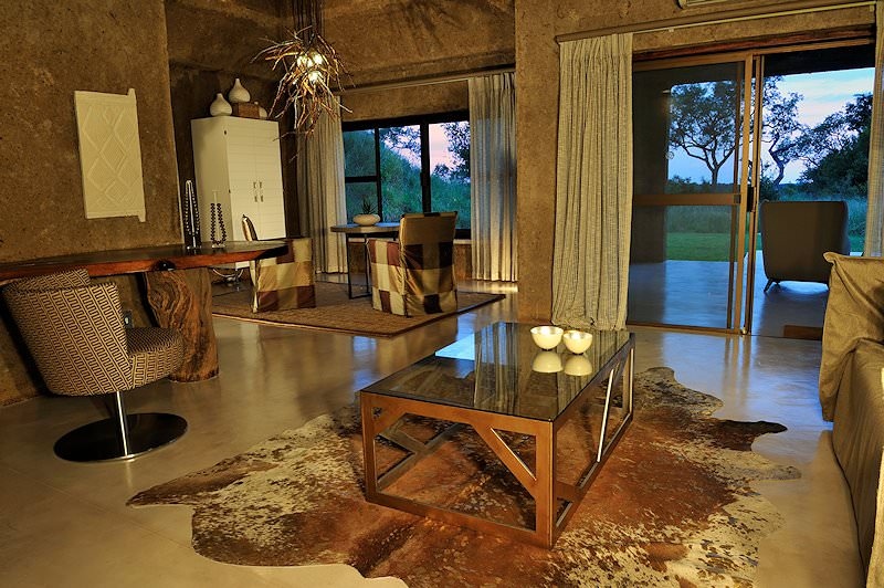 The interior of a suite's lounge at Sabi Sabi Earth Lodge.