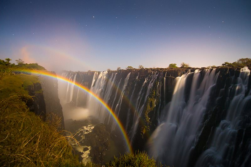 A rainbow forms in the mists of the Victoria Falls.