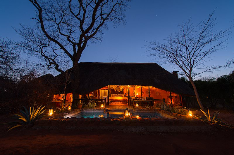 Stanley Safari Lodge lit up at night.