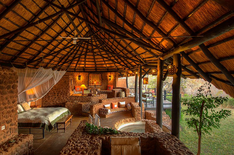 The bedrooms are open-air at Stanley Safari Lodge.