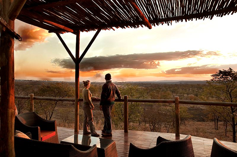 Guests at Elephant Camp enjoy the sunset.