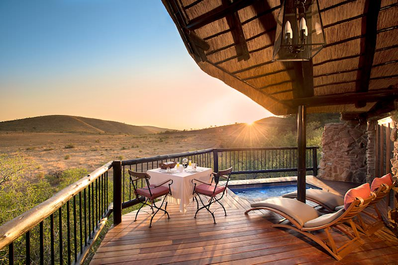 The private deck and plunge pool of a suite at Tshukudu.