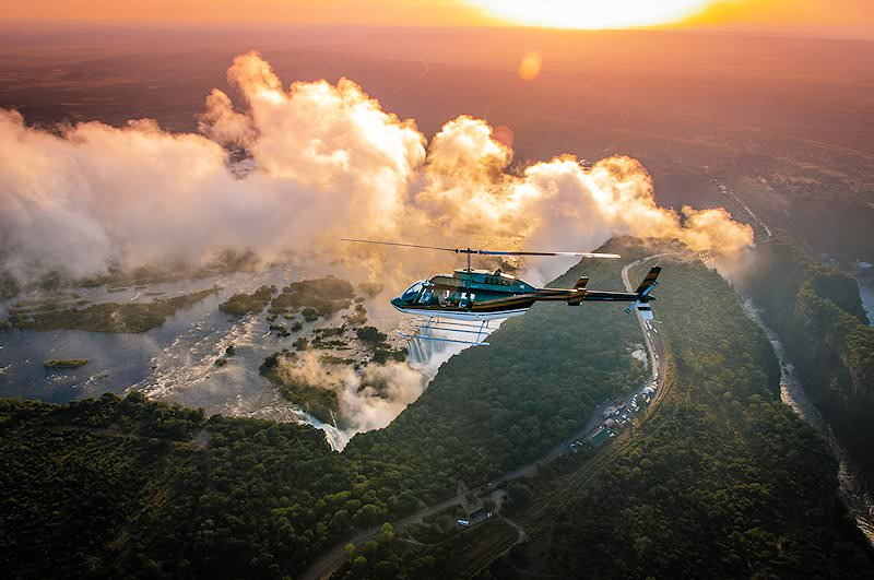 A sunset helicopter flight above the Victoria Falls.