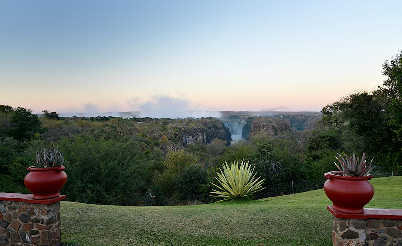 The mists of the Victoria Falls as seen from the Victoria Falls Hotel.