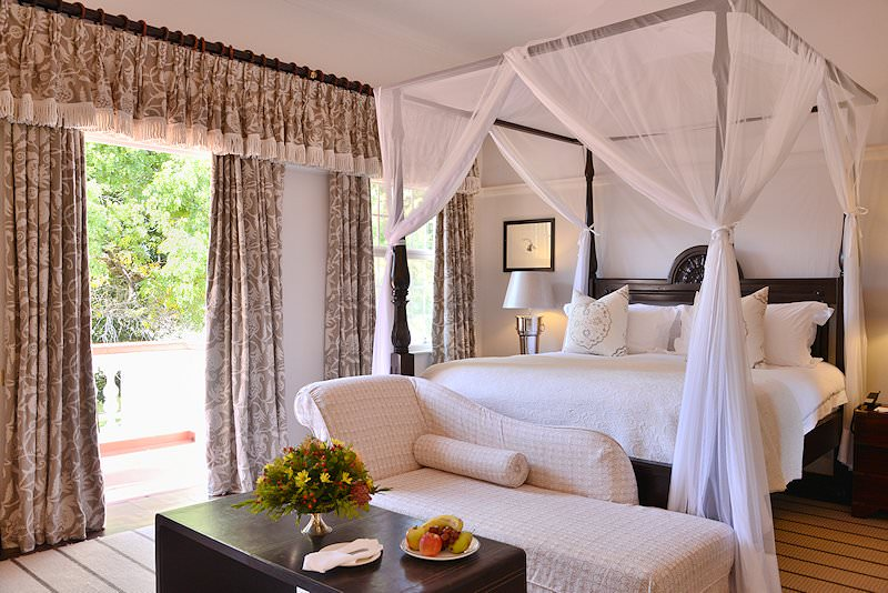 A sumptuous four-poster bed in a room at the Victoria Falls Hotel.