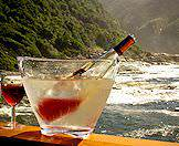 A chilled rose is served with a view of the rugged shores of the Garden Route.
