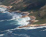 Forested mountains melt into the rocky shores of the Garden Route.