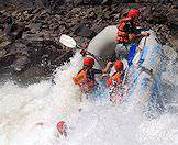 White water rafters hit a particularly treacherous rapid.