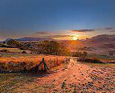 The sun sets over the Drakensberg Mountains where they descend into the plains of the Free State.