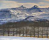 The snow-shrouded peaks of the Drakensberg Mountains in South Africa.