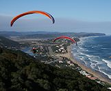 Hang gliders soar above Wilderness in the Garden Route.