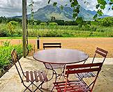 A patio with beautiful views of the Cape winelands.