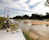 A private drink with views of the Sand River at Dulini Lodge.