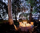 A candlelit dinner on the edge of the Zambezi River.