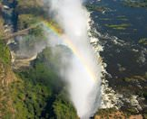 The mists of the thundering Victoria Falls spiral into the air.