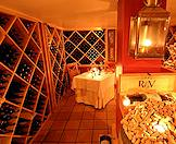 A private dinner candlelit dinner in a wine cellar.