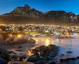 Camps Bay lit up at dusk.
