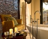 The interior of an en suite bathroom at Lion Sands River Lodge.