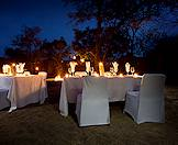 Candles and lanterns light up an evening meal in the boma area at Arathusa.