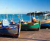 Traditional fishermen's boats beached on the harbor in Arniston.