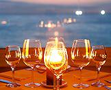 A table set for a candlelit dinner with a view of the Indian Ocean.