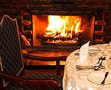Cozy fireside dining at Mount Sheba in the Mpumalanga highlands.
