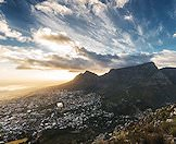The sun rises over Cape Town and Table Mountain.