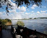 The mists of the Victoria Falls as seen from the deck of the Royal Livingstone.