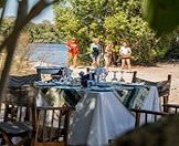 Guests arrive for a private lunch on the banks of the river.
