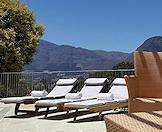 Poolside loungers at Le Franschhoek in the Cape winelands.