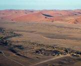 A dramatic aerial view of Kulala Desert Lodge.