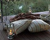 Champagne, candles, cushions and a blanket specially prepared for guests.