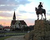 The sun rises over the Christ Church and Equestrian Monument in Windhoek.