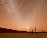Breathtaking stars and galaxies illuminated above Deadvlei in Namibia.