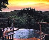 The sun sets over a private plunge pool at Phinda Rock Lodge.