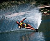 A guest water skis on a dam in Sun City.