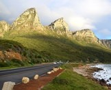 Camps Bay Road passes beneath the peaks of the Twelve Apostles.