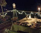 Dinner lit with a candelabra overlooking the Knysna Lagoon.