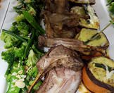 A delectable platter of lamb chops and vegetables.