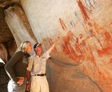 A guest learns about the San rock art on the Bushmans Kloof Reserve.
