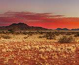 Rugged mountains and scarlet sands characterize the Namib-Naukluft National Park.