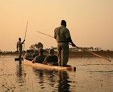 Rangers propel guests across the delta in tradtional wooden canoes.