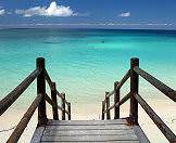 Step down onto the beach from a sturdy wooden staircase.