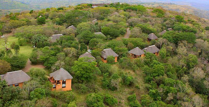 An aerial view of Hilltop Lodge's chalet scattered amidst the wilderness of Hluhluwe-iMfolozi.