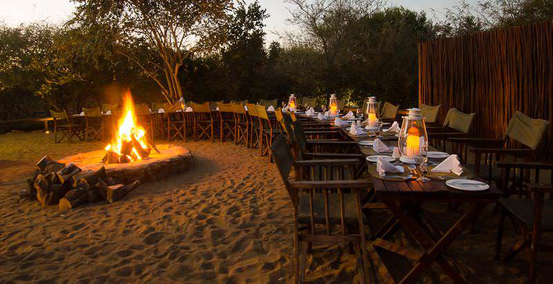 An inviting boma evening setup at Shishangeni Camp in the Kruger National Park.