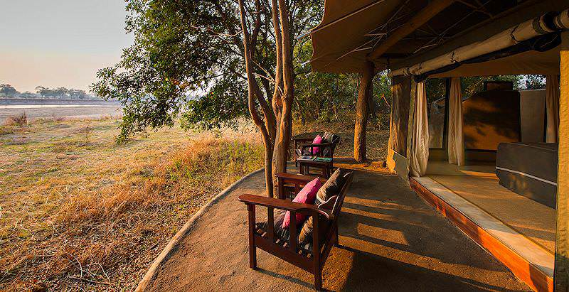 The wilderness of South Luangwa surrounds the tidy chalets of Tena Tena Camp in Zambia.